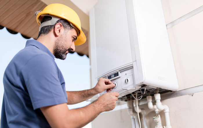 repairman fixing water heater